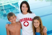 lifeguard with children at pool
