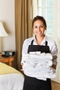 maid in hotel with towels
