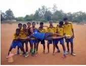 A team of players holding their instructor in Africa